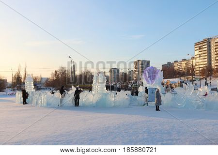 PERM RUSSIA - JAN 18 2017: People walk in Perm Ice Town 2017 Ekosad - largest in Russia at day