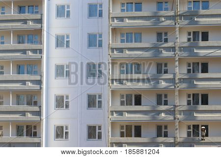 Part of apartment building of bearing-wall construction with balconies at sunny day