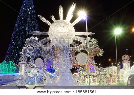 PERM RUSSIA - FEB 1 2017: Sculpture Ice sun at night Ice town of Perm in 2017 Ekosad - largest in Russia