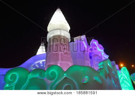 PERM RUSSIA - FEB 1 2017: Castle with illumination in Perm Ice Town 2017 Ekosad - largest in Russia at night
