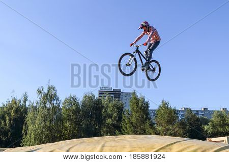 PERM RUSSIA - August 20 2016: The cyclist makes the extreme jump in aeromat nicely caught in the frame as the guy hung in the air