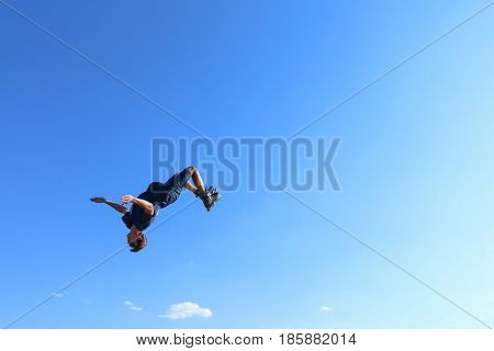 PERM RUSSIA - August 20 2016: Young man in blue denim breeches jumps during the event the Championship of Perm Krai jump aeromat