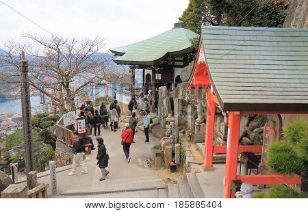 HIROSHIMA JAPAN - MARCH 18, 2017: Unidentified people visit Senkoji temple in Onomichi Onomichi is a historical city with many temples and small alleys.