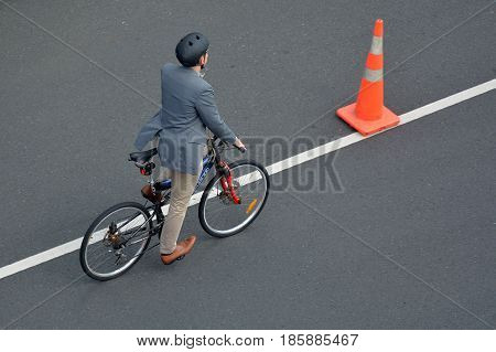 Aerial View Of A Man Cycling On City Road