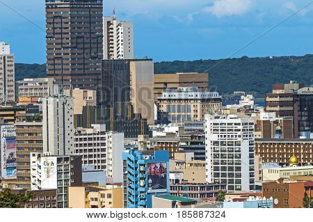 DURBAN SOUTH AFRICA ; APRIL 16 2017: Close up above view of Durban City center buildings against blue sky in South Africa