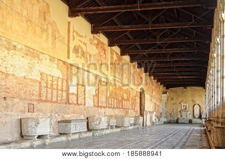 Frescoes and sarcophagi in the hallway of the Cemetery (Camposanto) on the Square of Miracles (Campo dei Miracoli) in Pisa, Tuscany, Italy - 8 October 2011