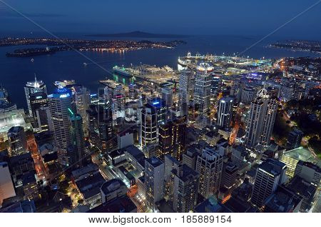 Aerial View Of Auckland City Central Business District With Waitemata Harbour At Dusk
