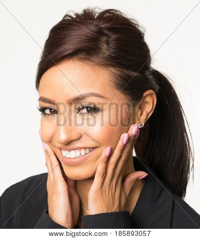 Smiling happy woman with hands on face