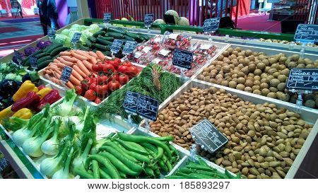 Greengrocery with shelf with fresh vegetables and fruits
