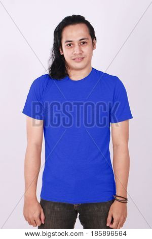 Photo image of an Asian Model smiling and showing blank blue T-Shirt front view shirt template