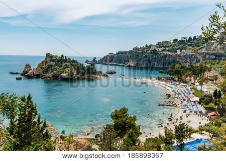 Aerial view of island and Isola Bella beach and blue ocean water in Taormina, Sicily, Italy