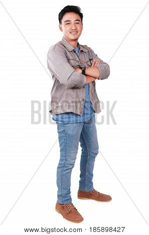Photo image portrait of a cute young successful Asian male student smiling and standing with arms crossed in front of his chest full body portrait isolated on white