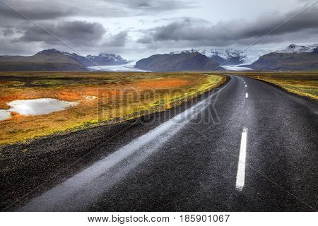 Scenic view of highway and glaciers in the south of Iceland