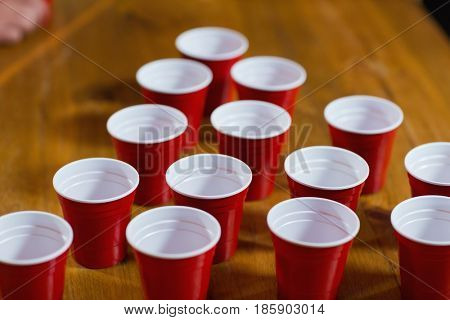 High angle view of empty disposable cups on table in bar