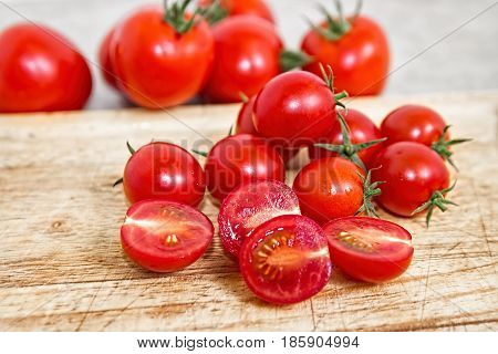 Cherry tomatoes on a wooden cutting board. Vegetable background. Healthy eating. Bio products.