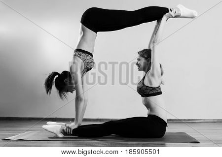 Black and white photo of two sportswomen in gym