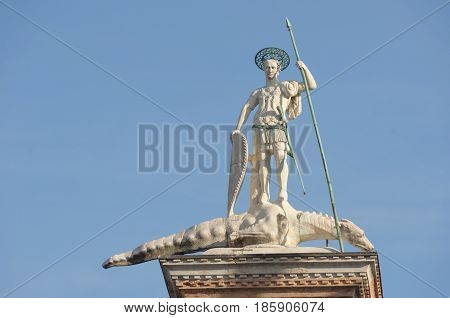 Close-up of St. Theodore's Column in St. Mark's Square with blue sunny sky. At the city of Venice the historic and amazing marine city. Located in Veneto region northern Italy
