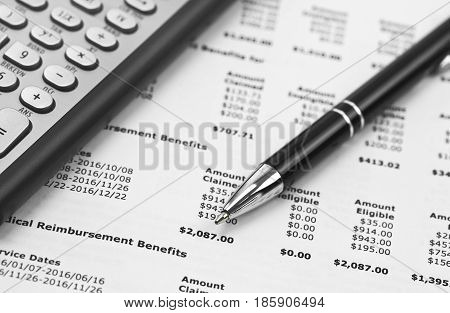 Pen and calculator on the Financial document