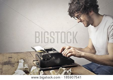 Passionate young writer using a typewriter