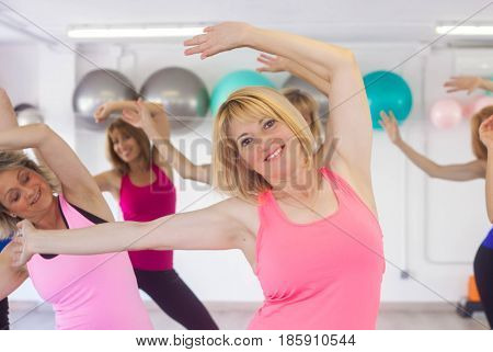 fit healthy women doing exercise