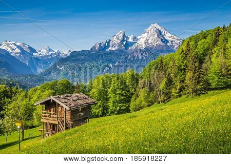 Idyllic Mountain Scenery With Old Chalet In The Alps In Springtime