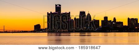 Sunset at Detroit River. General Motors Headquarters in Downtown Detroit, Michigan. Selective and soft focus.