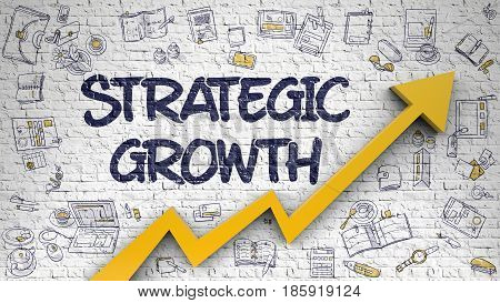 White Brick Wall with Strategic Growth Inscription and Orange Arrow. Development Concept. Strategic Growth Drawn on White Brick Wall. Illustration with Doodle Design Icons.