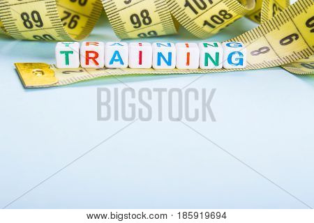 Measuring tape of yellow color and inscription by malinkish beavers training. blue or blue background Empty space for copy paste text