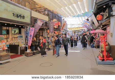 HIROSHIMA JAPAN - MARCH 19, 2017: Unidentified people visit Miyajima old shopping street.