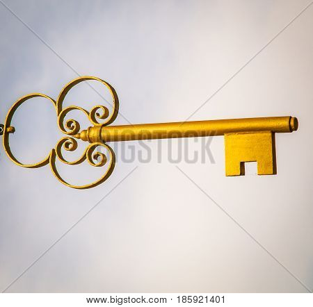 A golden key floating in the air
