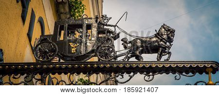 Iron horse and carriage statue on a post in Austria
