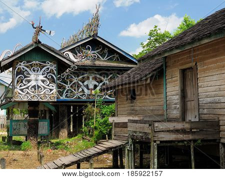 The culture and beliefs of the island Borneo. Traditional Dayak tribal culture. Decorated front of Dayak house - long house. Kalimantan Indonesia
