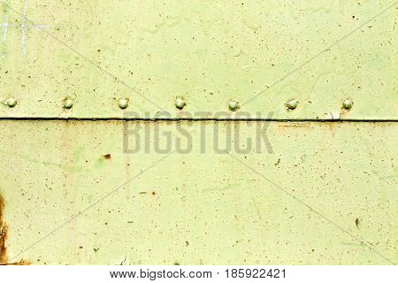 Rusty Metal Plate Surface With Rivets.