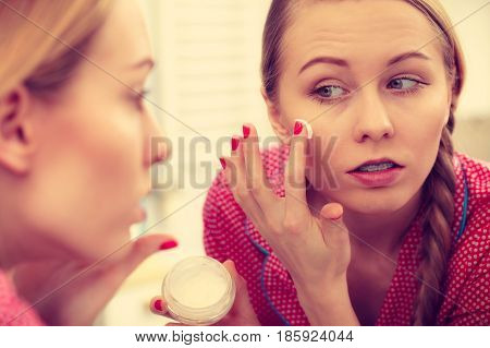 Woman Applying Moisturizing Skin Cream. Skincare.