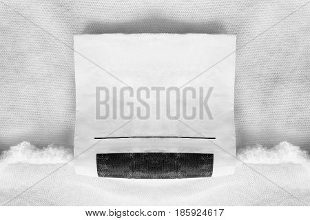 Blank clothes label on white cloth as a background