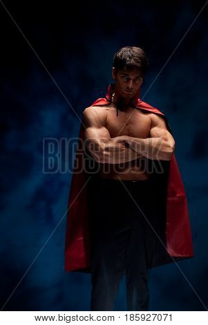 The buff vampire is crossing his arms ready for love.