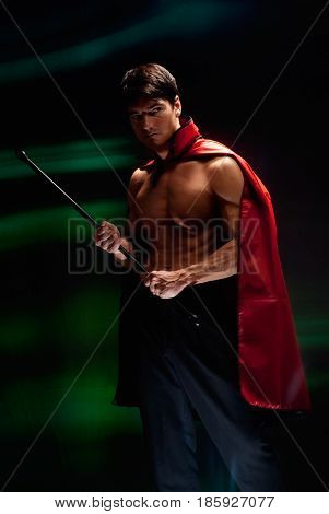 The sexy man is dressed like a vampire.