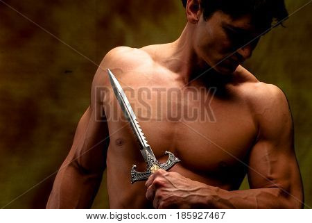 The sexy buffed vampire prepares for battle.