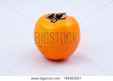 Delicious ripe fruit.Persimmon.Delicious ripe fruit.Persimmon.A lot of vitamins.