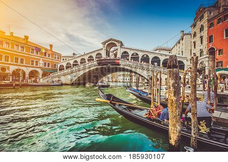 Panoramic View Of Canal Grande With Famous Rialto Bridge At Sunset In Venice, Italy With Retro Vinta