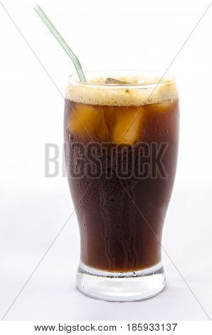 A glass of iced coffe on white background the coffee is the greek frappe