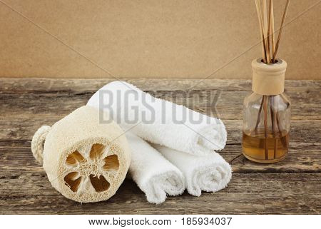 Spa composition with massage brushes and aroma therapy on wooden background, weight loss and skin care concept