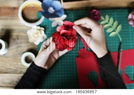 People making paper craft flower art