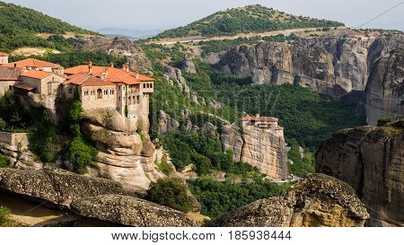Beautiful scenic view of the Varlaam and Rousanou Monastery on a monolithic pillar in Meteora, Greece