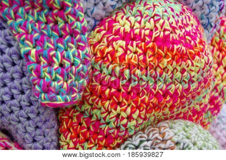 The handmade wool caps in variegated colors