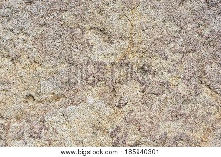 A background of the texture natural rock. The texture of the stone. Design texture. Pattern rocks.