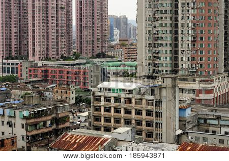 Weathered apartment buildings in the Xiguan district in the city of Guangzhou China near Shang Xia Jiu Pedestrian Street on an overcast day in Guangdong province.