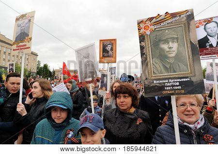 Orel Russia - May 9 2017: Victory Day selebration. People in Immortal regiment march holding portraits of their war hero relatives in hands