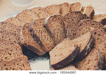 Plenty of sliced bread background. Bakery or catering concept. Fresh, healthy whole grain sliced sorts of rye loaves, food closeup.