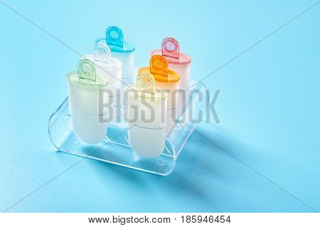 Plastic ice cream lolly form molds stand on plexiglass stand